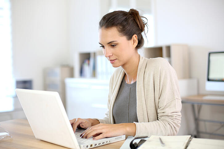 woman working in office on laptop