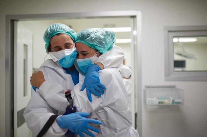 Two nurses hugging