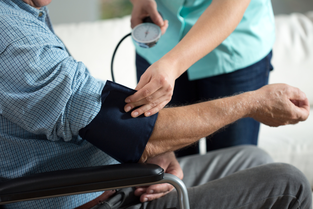 Close-up of assessment elderly patients blood pressure