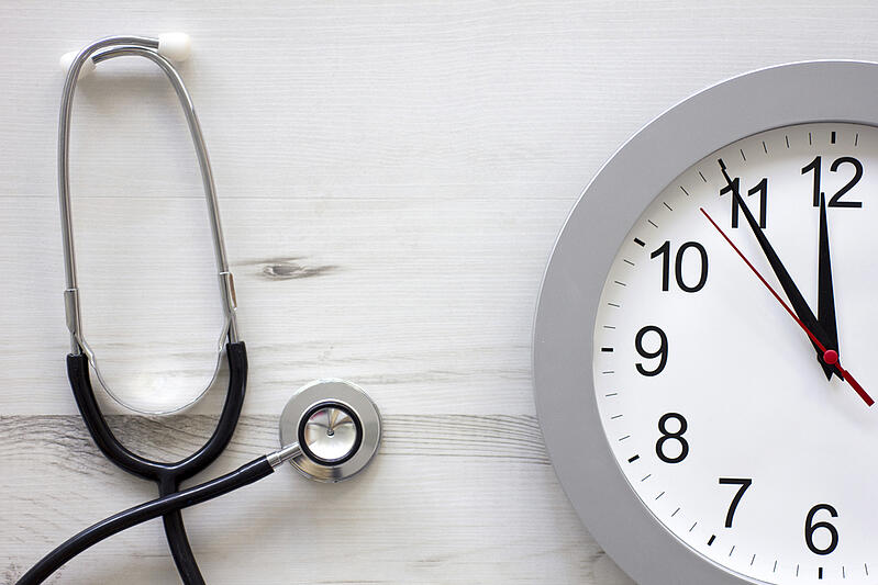 Concept showing doctors stethoscope and a clock face simulating an appointment-1