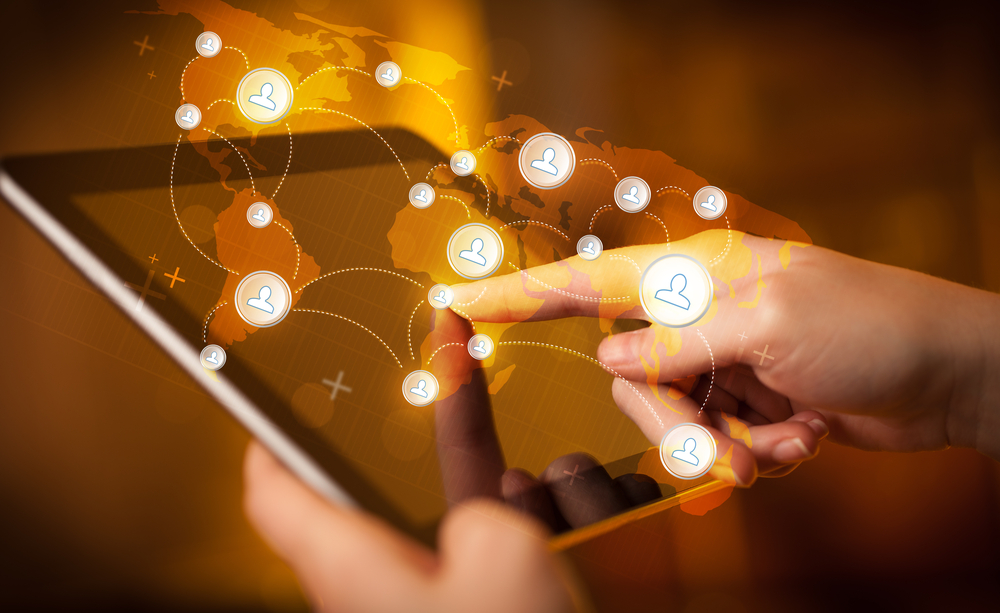 Finger pointing on tablet pc, social network concept-1