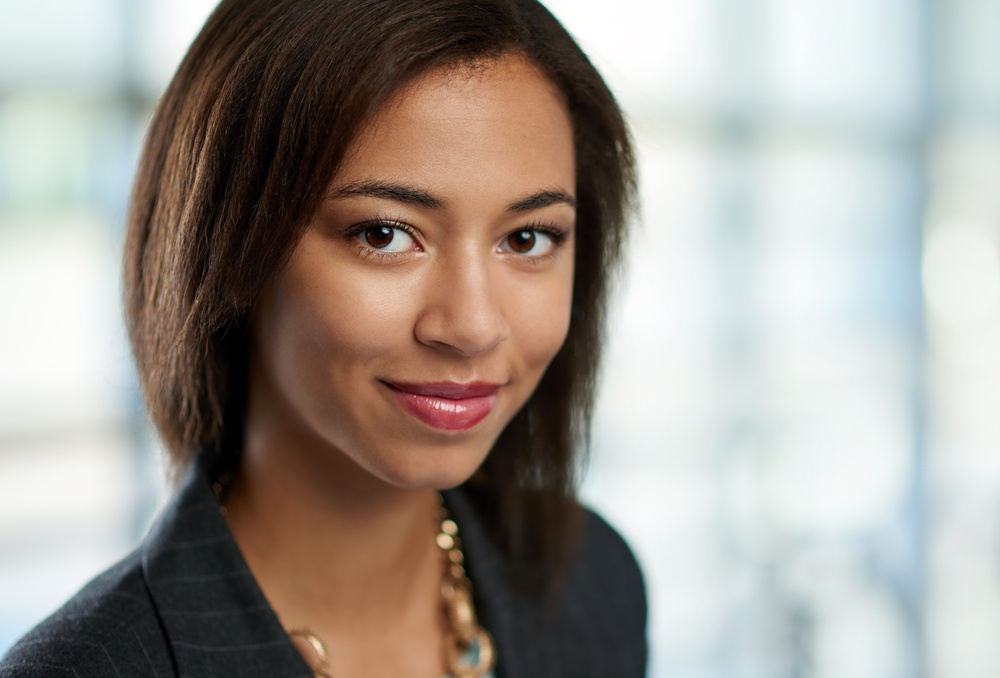 Horizontal headshot of an attractive african american business woman shot with shallow depth field..jpeg