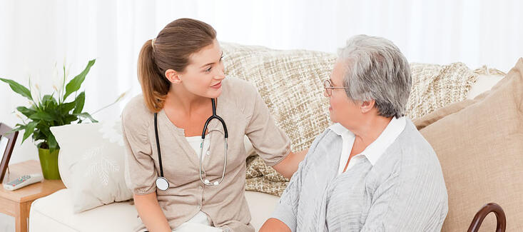 Nurse talking with her patient at home.jpeg