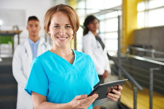 nurse and team in bright modern office-1.jpeg