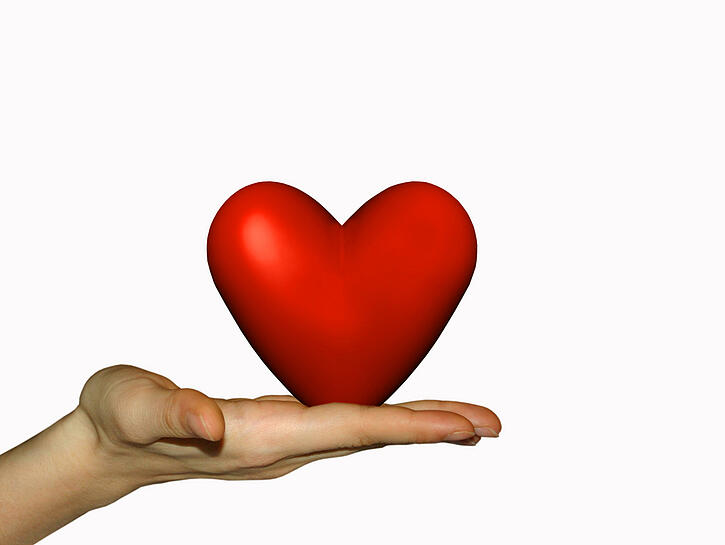 Red Heart on a hand being offered