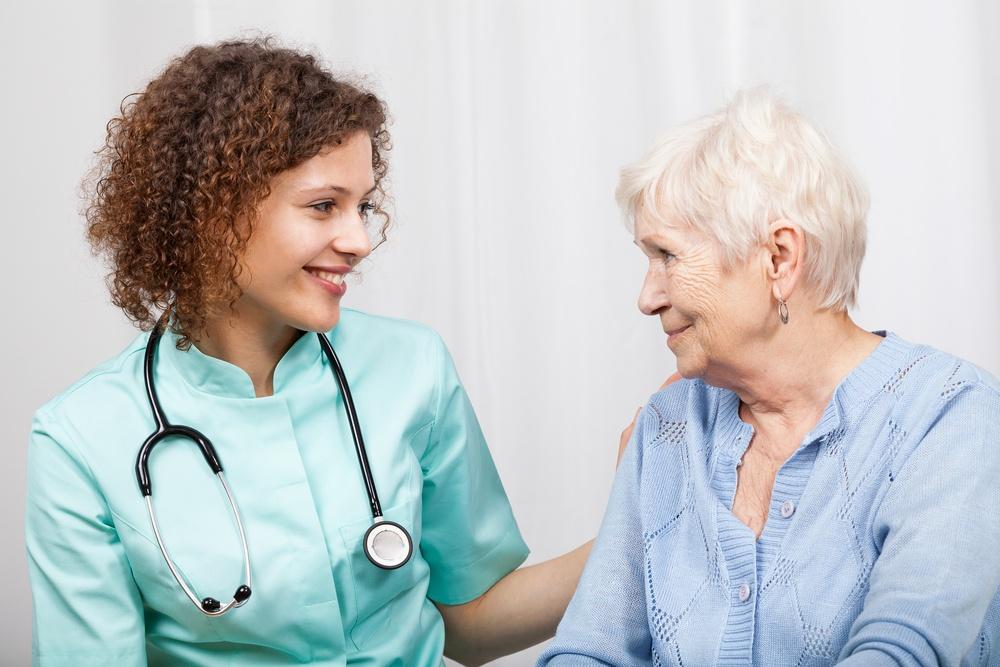 Smiling nurse and happy elderly lady, horizontal.jpeg