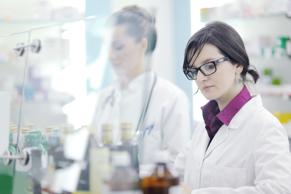 team of  pharmacist chemist woman group  standing in pharmacy drugstore-1